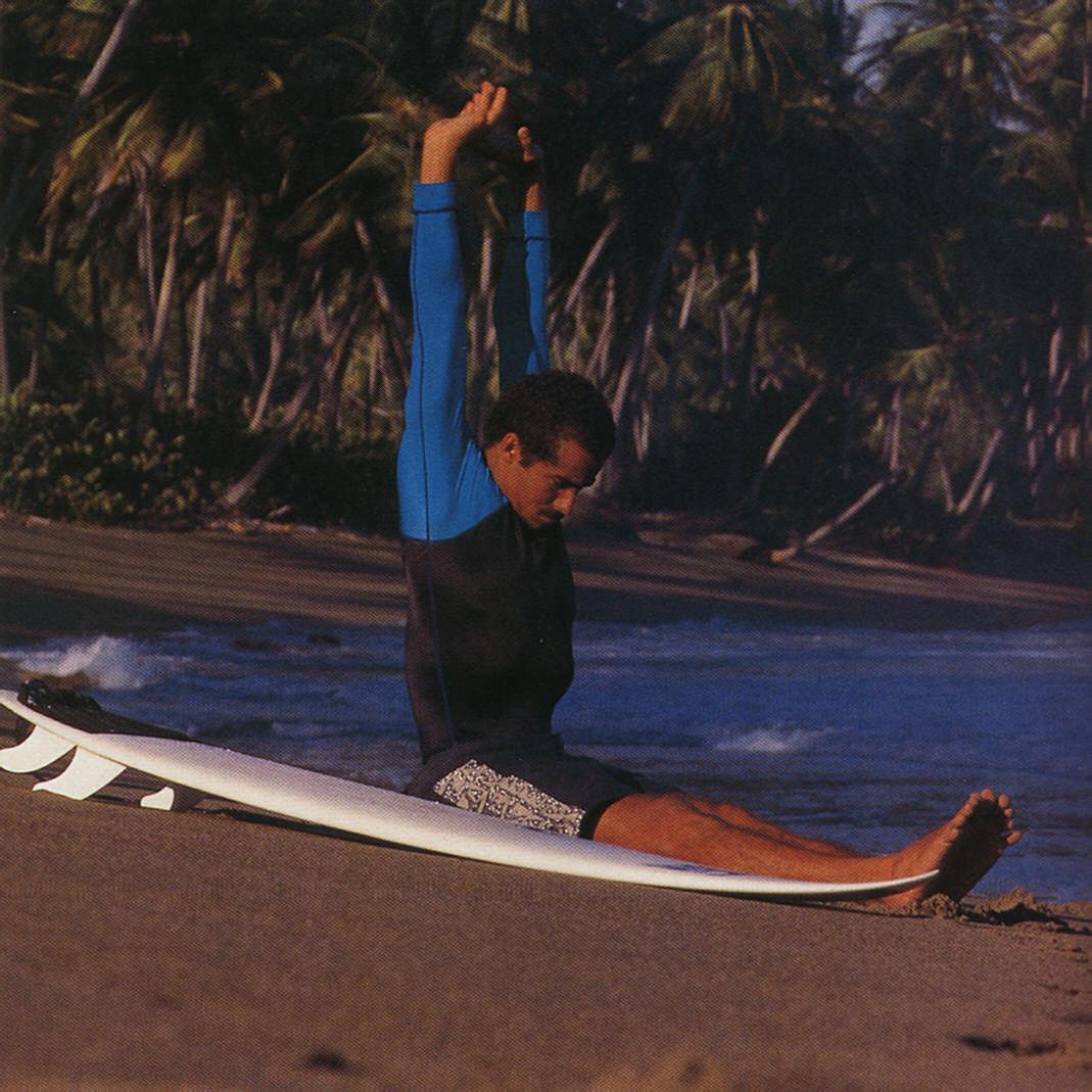 Jason prepares to ride the waves. Photograph by Allan Weisbecker