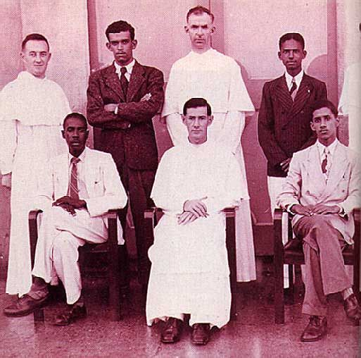 Walcott, second from left back row, on the staff at his old school in St. Lucia. Photograph courtesy Derek Walcott