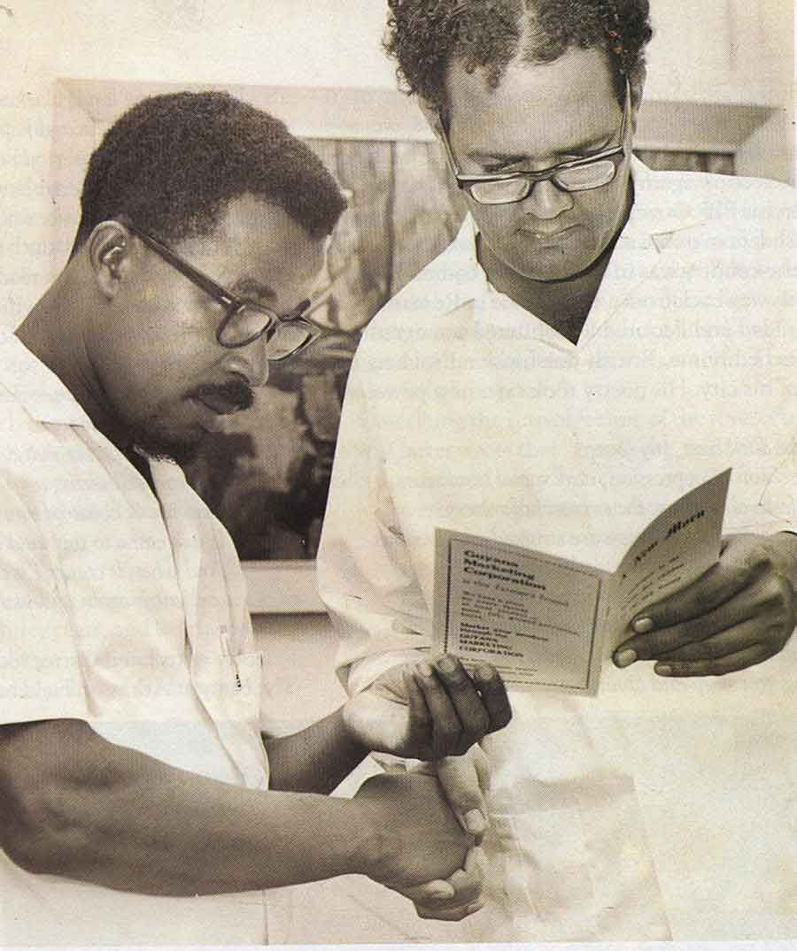 Receiving a book from aspiring poet Ernest Perry. Photograph courtesy Mirror Achives, Georgetown