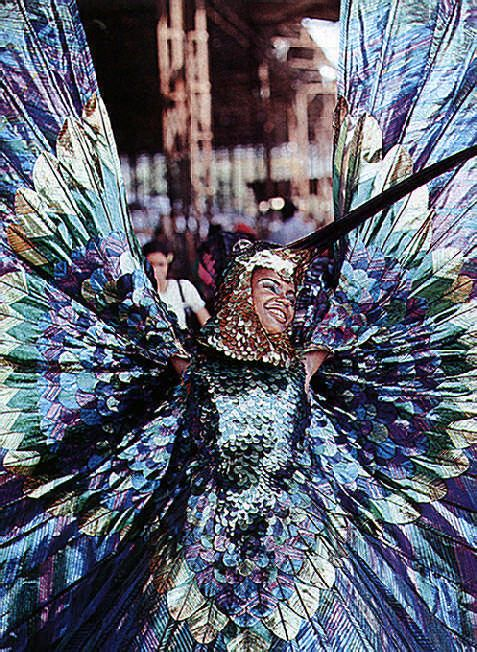 "Minshall's sister Sherry Ann Guy in the costume he created for her in 1974: ""From the Land of the Hummingbird"""