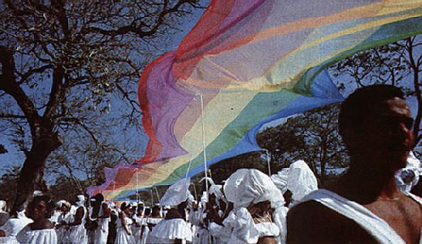 """""""River"""" (1983): The River People rejoice beneath their canopy of rainbow promises. Photograph by Jeffrey Chock"""