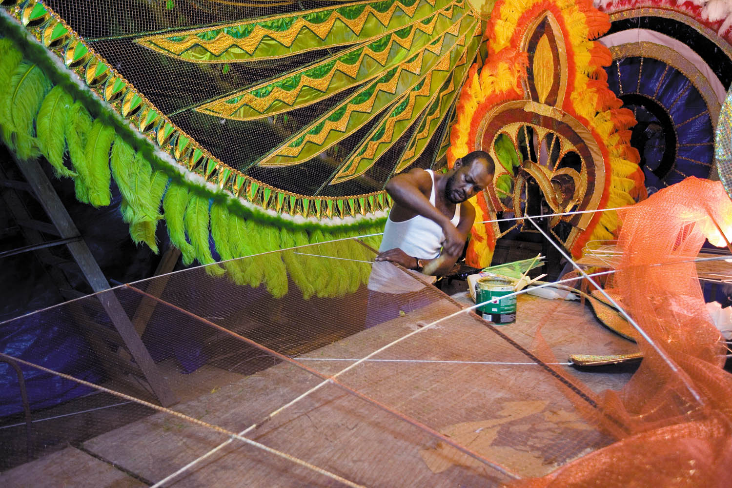 Rodney Duncan prepares the frame for Ohina, Lady of D' Morning, one of two Queen contestants from Stephen Derek's D' Midas and Associates, who presented their band Amazonia on Carnival Monday and Tuesday. Photograph by Mark Lyndersay