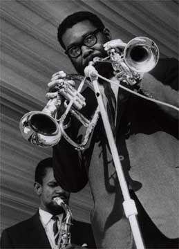 Shake Keane at the National Jazz Festival in 1963, playing trumpet & flugelhorn simultaneously, with Joe Harriott in background
