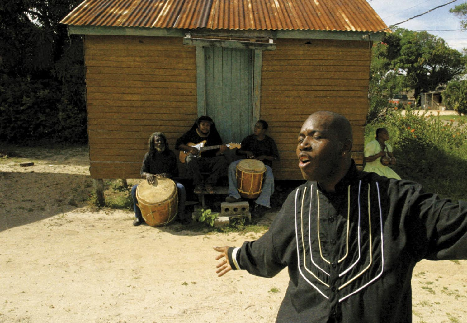 Andy Palacio with members of the Garifuna Collective in the background. Photograph courtesy Cumbancha/Tim O`Malley