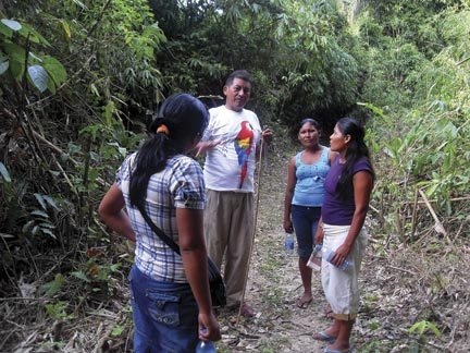 At home: Allicock in his native environment in the forest in Guyana with young fellow Amerindians. Photograph courtesy Surama Village Eco-Lodge
