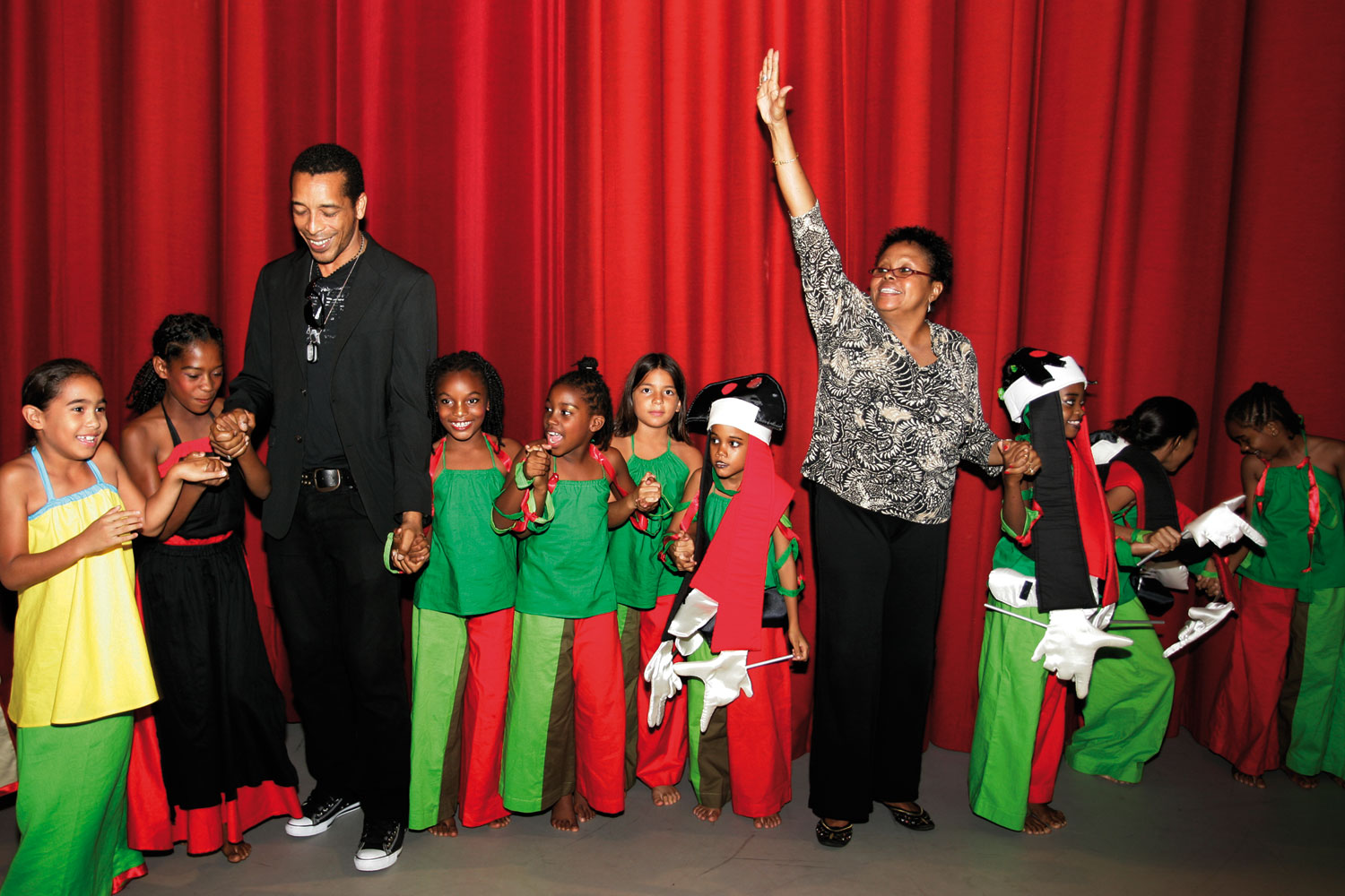 Douglas with drama teacher Wendell Manwarren and members of the Lilliput Children's Theatre backstage. Photograph by Marlon Rouse