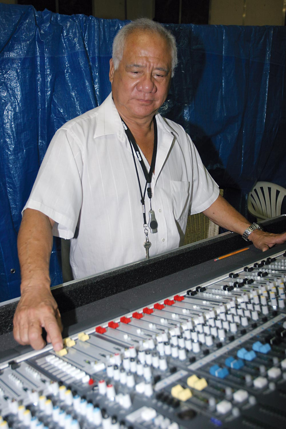 Byron Lee tweaking his mobile mixing console at a rehearsal at his Dynamics Sound Recording studio home in Kingston, Jamaica. Photograph by Roysweetland@gmail.com