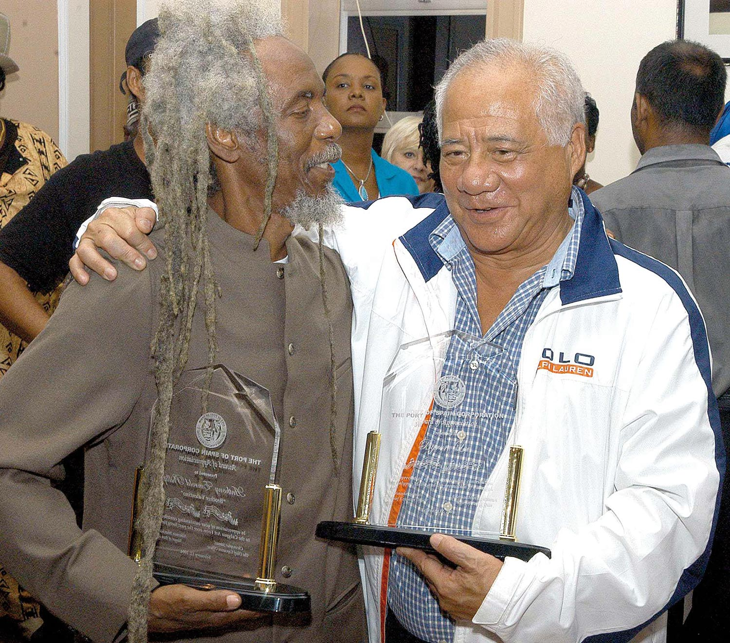 Caribbean icons in the entertainment industry calypsonian Brother Valentino (left) and Byron Lee with the awards they received from the mayor of Port of Spain, Trinidad. Photograph by Iossjr