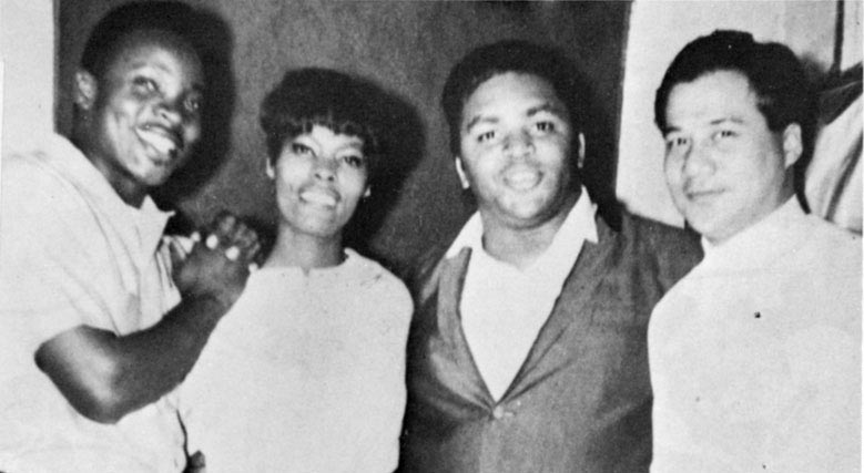 A triumphant Byron Lee poses with The Mighty Sparrow, Dionne Warwick and Solomon Burke. Photo courtesy Byron Lee