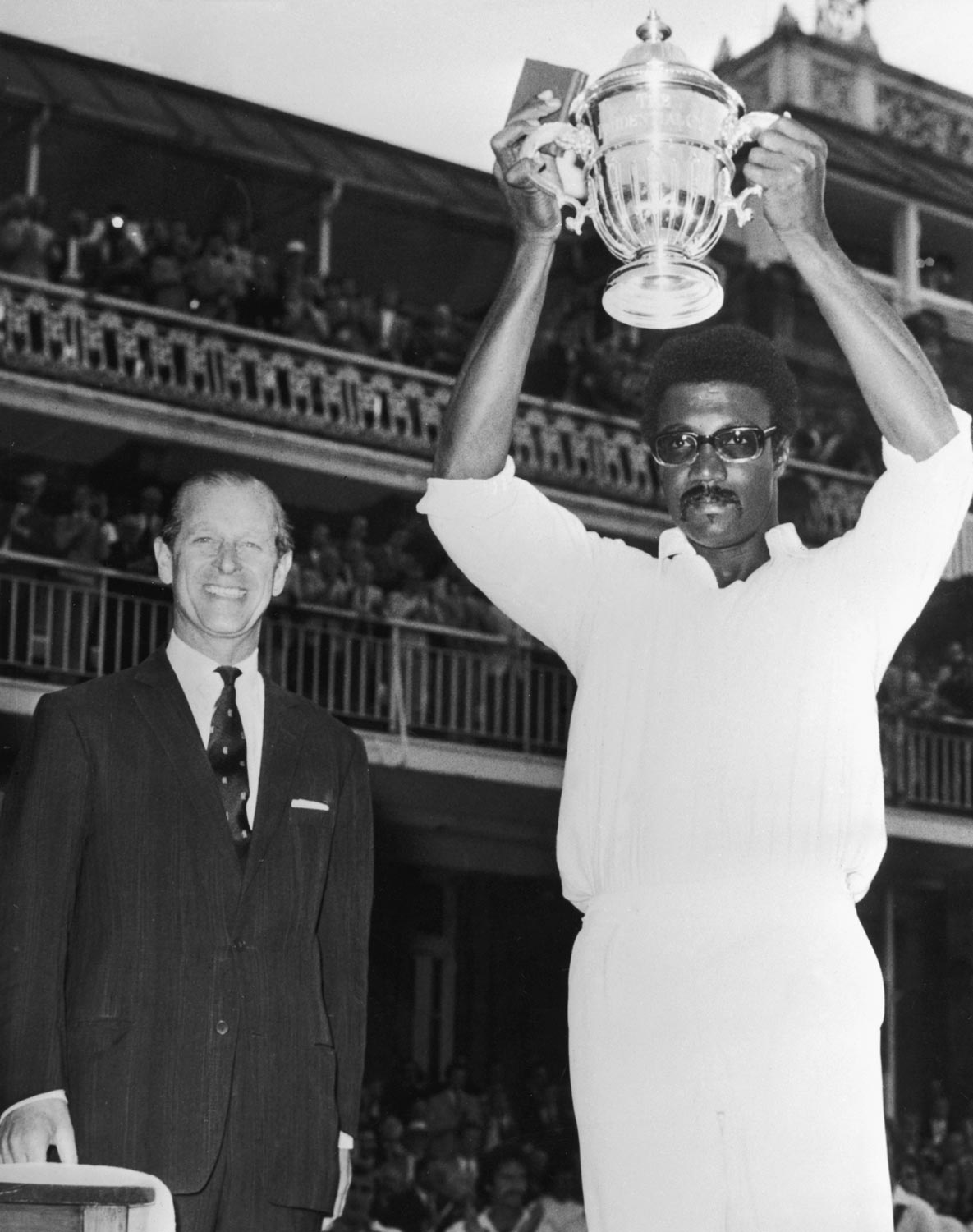 West Indies captain Clive Lloyd lifts the trophy at the 1975 Cricket World Cup, as MCC president Prince Philip, the Duke of Edinburgh, looks on. Photo by Keystone/Hulton Archive/Getty Images