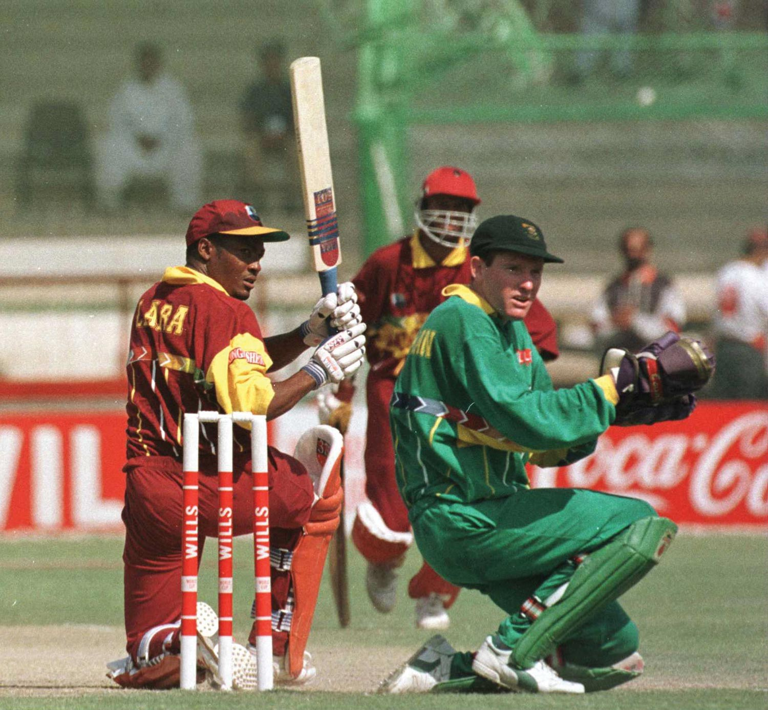 The West Indies' Brian Lara sweeps a shot on his way to 111 runs during the quarter-final match against South Africa in the 1996 World Cup. Photo by John Parkin/Allsport