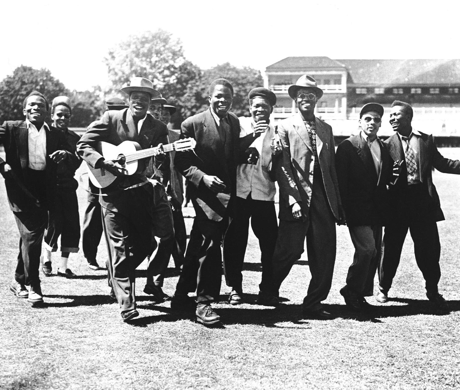 Lord Kitchener, (with guitar), leads a group of West Indies fans onto the pitch after seeing their team beat England. Photograph by Press Association Images