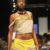 Farida Lecoin models a strapped tube blouse with flared skirt from The Cloth`s Hitting the Spot collection. Photograph courtesy Caribbean Fashion Week