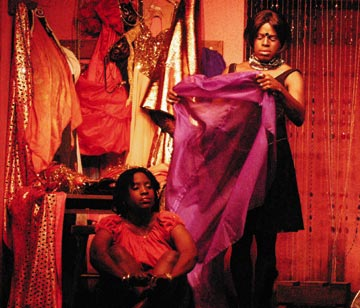 Quweina Roberts, sitting, and Conrad Parris in the Indiana State production of Lucky Diamond. Photograph by Jeffery Chock