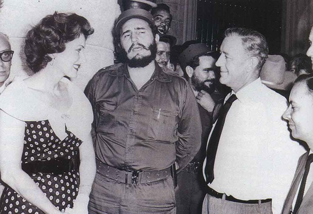 Maureen O'Hara, Alec Guinness and director Carol Reed (far right) listen respectfully to a young Fidel Castro during a break in the filming of 'Our Man in Havana'