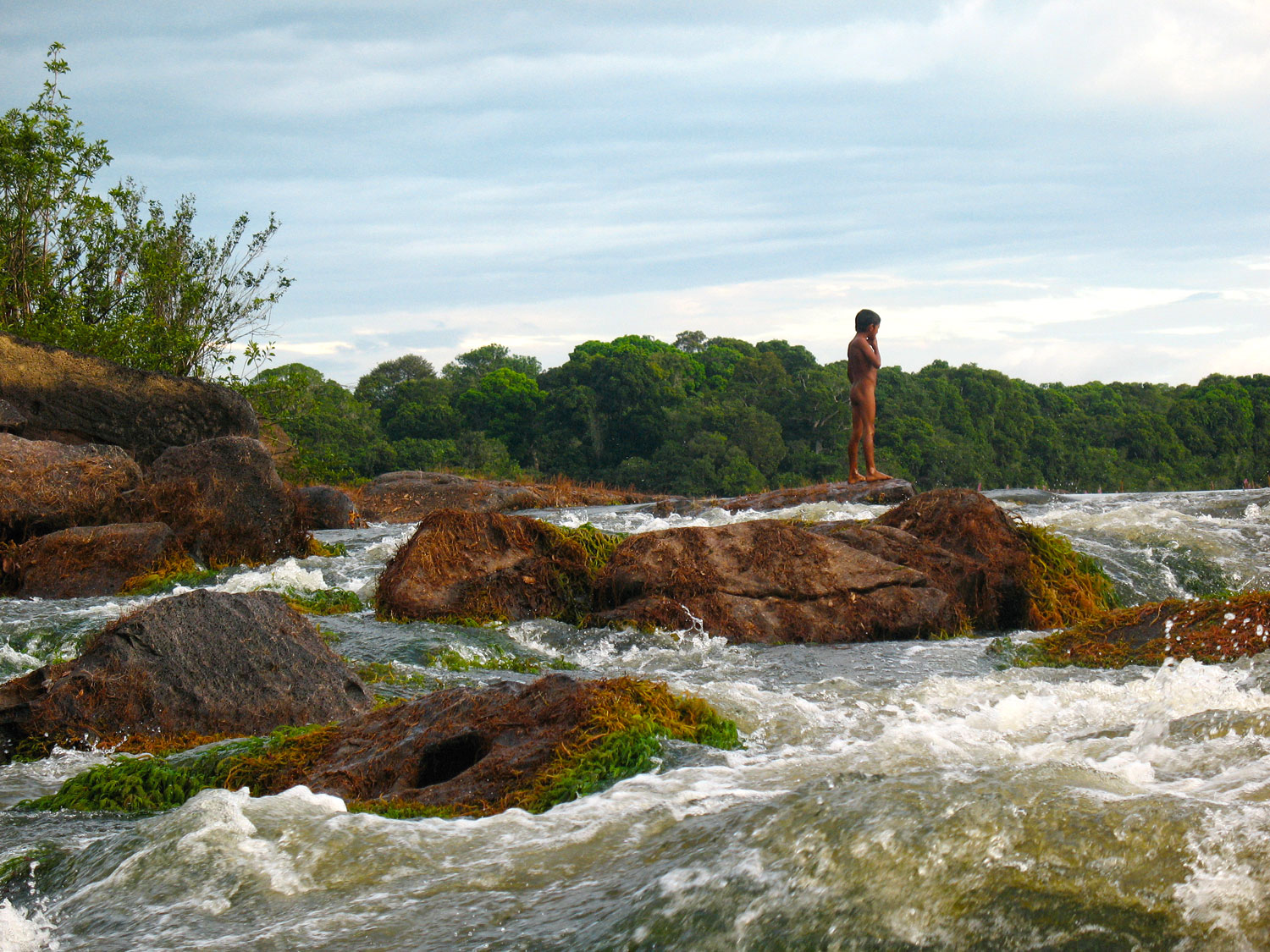 An Amerindian boy gets ready to jump into the rapids on the Essequibo River, near Fair View village. Photograph by Skye Hernandez